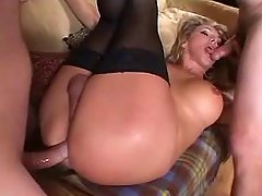 Blonde shemale gets cum on her lips